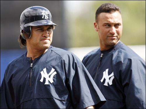 Damon and Derek Jeter acknowledge the crowd during a workout.