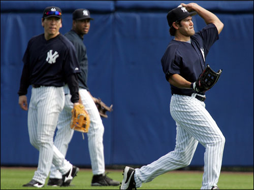 Fellow outfielders Hideki Matsui and Bernie Williams watched as Damon fielded fly balls.