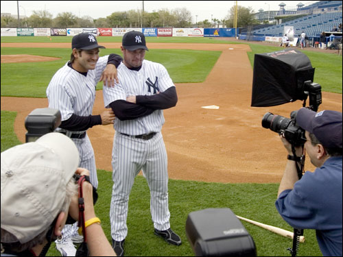 Teammates in Oakland and reunited in New York, Johnny Damon and Jason Giambi posed for some photos during the team's picture day.