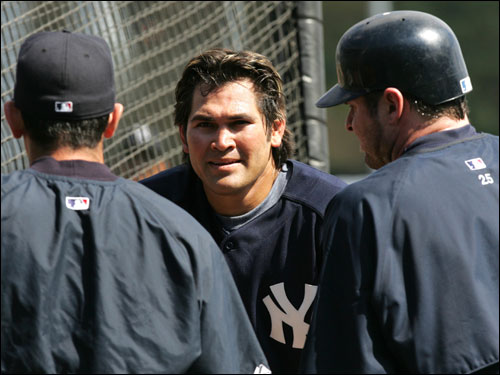Johnny Damon talked with coach Lee Mazzilli (left) and first baseman Jason Giambi while waiting for his turn to bat.