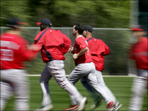 David Ortiz, Trot Nixon, and Dustan Mohr ran the bases after a shortened workout Tuesday due to a morning meeting.