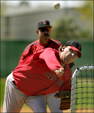 Schilling threw the ball under the watchfull eye of pitching coach Al Nipper.
