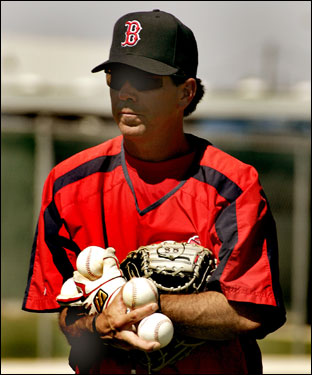 Bruce Crabbe, manager of the Lowell Spinners, and minor league infield coordinator, had his hands full retreiving balls after a drill Tuesday.