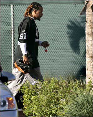 Ramirez walks to the clubhouse, glove in hand.