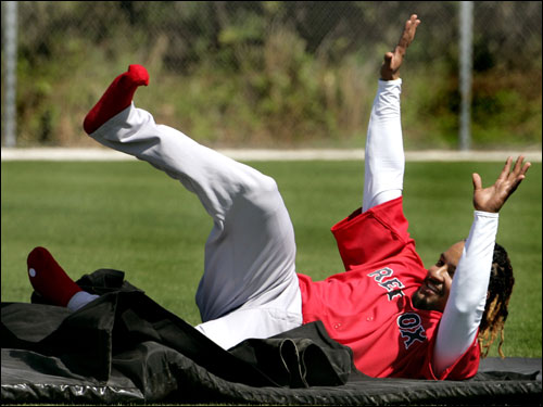 Manny practices sliding on a mat during Wednesday's team workout.