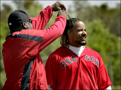 David Ortiz checks out Manny's new longer hair style during workouts Wednesday.