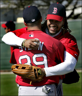 Manny Ramirez greeted Adam Stern with a hug after he took to the field for his first spring workout with the Red Sox Wednesday.