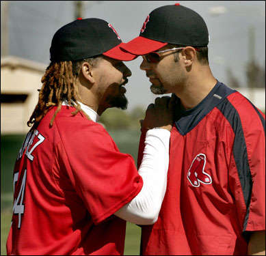 Manny Ramirez greets new teammate Mike Lowell.