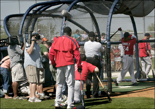 Manny Ramirez drew a crowd around the cage for his first hacks of the spring.