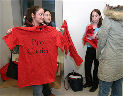 Loretta Jordan checked out one of the T-shirts offered by the abortion rights supporters at Boston College Tuesday.
