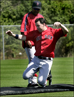 Trot Nixon worked on a sliding drill during Wednesday's workout.