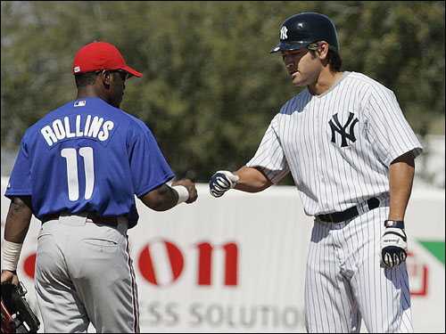 Damon was congratulated on his double by Phillies shortstop Jimmy Rollins.