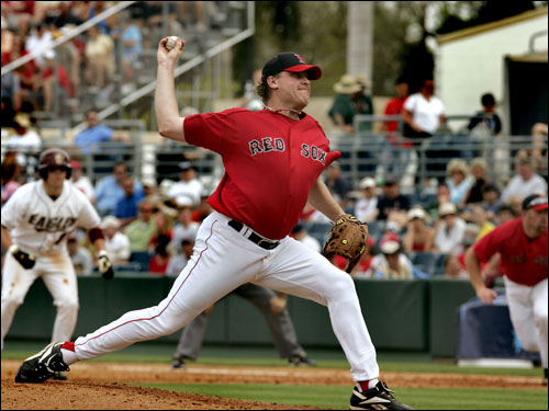 Curt Schilling pitches against Boston College during Friday's afternoon split squad game. In the background in Boston College's Jett Ruiz, who singled off Schilling in the 4th inning. Schilling pitched four innings in his first spring outing.