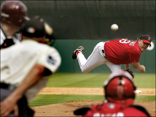 Red Sox starting pitcher Curt Schilling pitches to a Boston College batter during Friday's game at City of Palms Park.