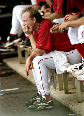 Curt Schilling looks out from the dugout after finishing his day pitching four innings against BC.