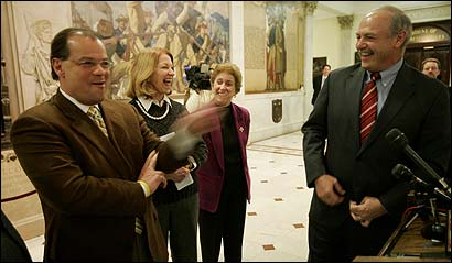 Senate President Robert Travaglini (left), Senator Therese Murray, Representative Patricia A. Walrath, and House Speaker Salvatore DiMasi shared a laugh yesterday about how the two legislative leaders came to a compromise on a new healthcare bill.