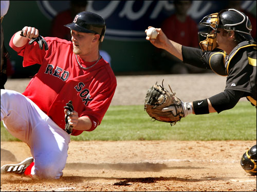 Pittsburgh catcher Ryan Doumit showed he had the ball after tagging out Luke Allen at home in the third inning.