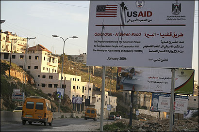 A USAID sign told of repairs being done to a rutted and potholed road linking the town of Ramallah to Jerusalem. With Hamas soon to assume power, funds for such projects are frozen.