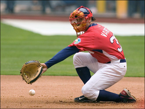 Varitek scooped a ground ball at first base.