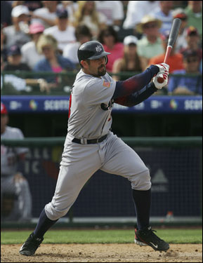 Jason Varitek hit a line drive during an exhibition game against the San Francisco Giants at Scottsdale Stadium.