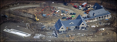 BERKSHIRES VACATION HOME -- The Patricks are building a 24-room, 10,000-square foot mansion on 77 acres in Richmond, a rural town drawing affl uent second-home buyers. They are carrying mortgages of $4.6 million on the Richmond house and 14 acres adjacent to it.