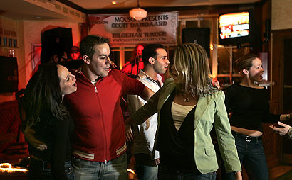 Specialists fear that some young women have a false sense of security in cities. Dancing at Hennessy's in Boston early yesterday were (from left) Kristen Lyttle, Adam Manoli, and Liz Weidman, with Michael Holtzin and Leah Martin behind them.