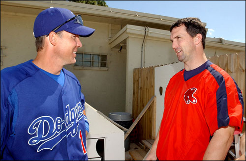 Thursday was reunion day at Vero Beach, as the Red Sox took on the Dodgers in a spring training game. Former teammates Bill Mueller (left), now the third baseman for the Dodgers, and Red Sox right fielder Trot Nixon chatted outside the locker room before the game.