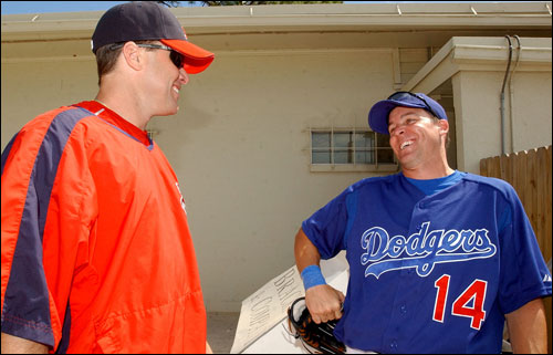Red Sox first baseman J.T. Snow (left), and Dodgers third baseman Bill Mueller (right) shared a laugh outside the clubhouse.