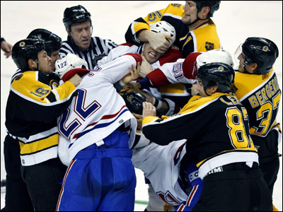 Hal Gill (top right) gets a grip — on Canadiens defenseman Craig Rivet's face — during this second-period scrum.