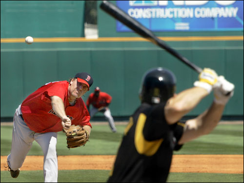 Red Sox starting pitcher Curt Schilling threw to Jack Wilson in the first inning. Schilling breezed through the first nine batters before running into trouble in the fourth inning, giving up four runs on four hits.
