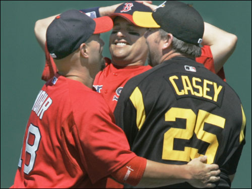Dustan Mohr and J.T. Snow greeted Pirate Sean Casey before the game.