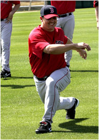 Red Sox pitcher Keith Foulke stretches out his surgically repaired knee before a spring training workout.