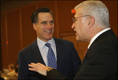 Governor Mitt Romney, with Chamber of Commerce head Paul Guzzi, said ''our responsibility to the children comes first.''