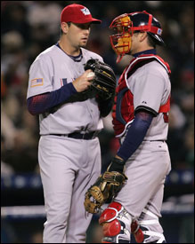 Pitcher Dan Wheeler and catcher Jason Varitek confer, but the US had no answers for Korea.