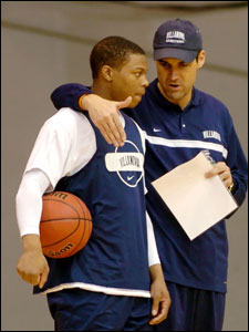 Villanova coach Jay Wright gives Kyle Lowry instructions in practice.