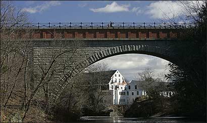 Echo Bridge spans the Charles River, connecting Newton to Needham.