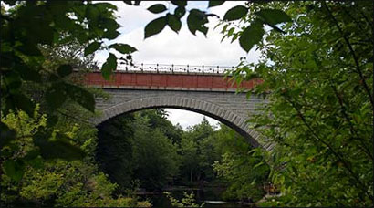 Echo Bridge spans the Charles River, connecting Newton to Needham.