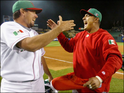Benji Gil (left) and Geronimo Gil can't hide their feelings as they celebrate Mexico's 2-1 upset over the United States.