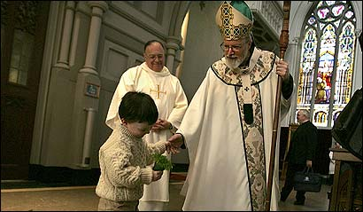 Aidan Dowling, 3, of Roslindale, greeted Archbishop Sean P. O'Malley, who will be made a cardinal next week, after the St. patrick's Day Mass in Cathedral of the Holy Cross in the South End.