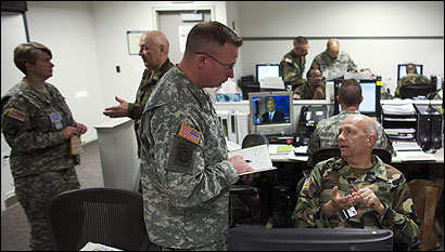 Members of the Pentagon&#146;s Crisis Action Team exchanged information last week.