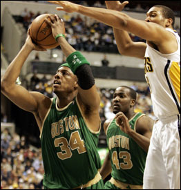 The Celtics' Paul Pierce seems unaware of the Pacers' Danny Granger as he puts up a shot. Pierce finished with 22 points in the Celtics' come back victory at Conseco Fieldhouse.