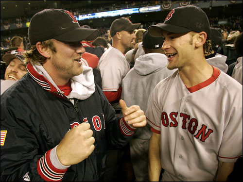 Bronson Arroyo (right) and Derek Lowe celebrated on the field at Yankee Stadium after the Sox completed their historic comeback in the ALCS.
