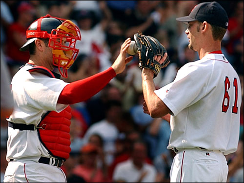 Bronson Arroyo made his Red Sox debut in relief of Pedro Martinez, pitching three shutout innings against the Mariners to pick up a save. The Red Sox acquired Arroyo on Feb. 4, 2003, claiming him off waivers from the Pittsburgh Pirates.