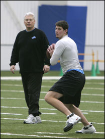 With Joey Harrington out of the picture, Detroit Lions QB coach Mike Martz works with holdover Dan Orlovsky yesterday.