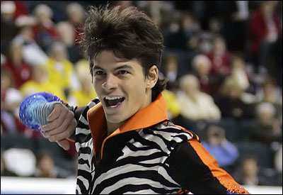 Stephane Lambiel, battling a knee injury, won his qualifiying group at the World Figure Skating Championships.