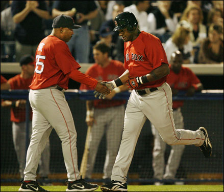 Red Sox third base coach Hale DeMarlo (left) congratulated the newly acquired Wily Mo Pena on his fourth-inning two-run homer off Yankees pitcher Shawn Chacon.