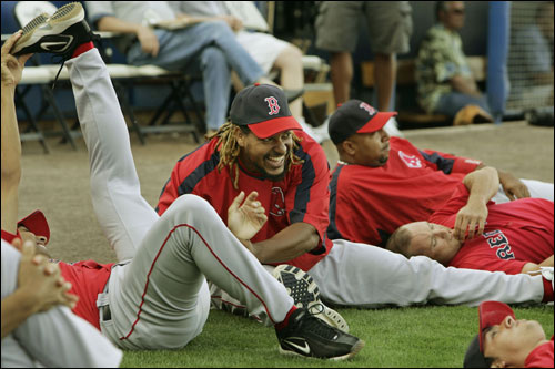 Red Sox left fielder Manny Ramirez clowned around while stretching with teammates prior to the game.