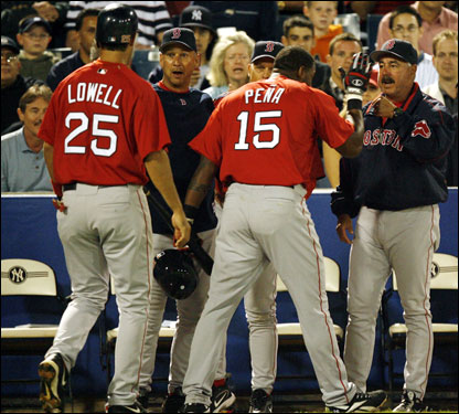 Red Sox manager Terry Francona, second from left, and pitching coach Al Nipper congratulate Mike Lowell (25) and Wily Mo Pena after Lowell scored on Pena's homer.