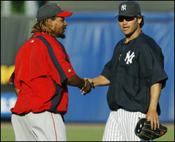 Old friends Manny Ramirez and Johnny Damon chat before last night's game.