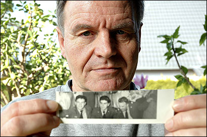 Herbert Hack of Berlin with a picture of his father, known as Charles (center in small photo), a former US soldier whom he is trying to locate.